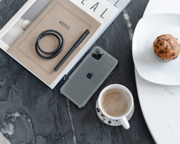 Mobile phone and coffee in coffee shop